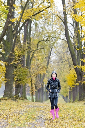 falltime: woman in autumnal alley