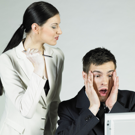 deranged: businesspeople at computer Stock Photo