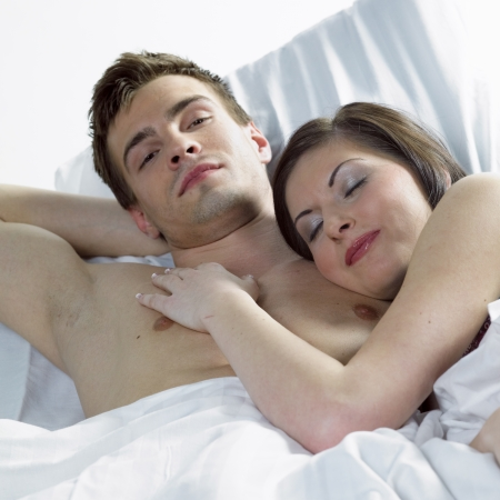 lying on bed: couple in bed