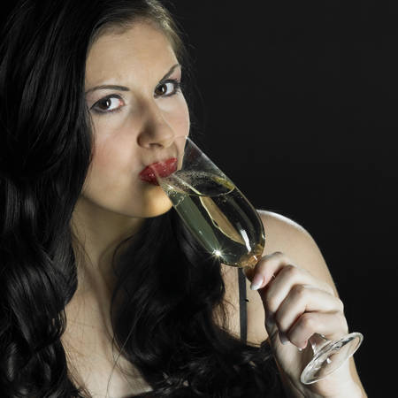 festival moments: portrait of woman with a glass of champagne