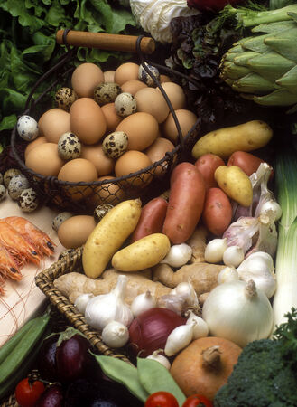 close up of onions in a basket: vegetables still life with eggs