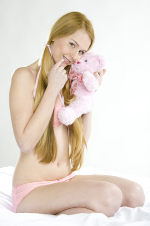 woman wearing underwear with teddy bear photo