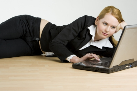 officeworker: lying businesswoman with a notebook