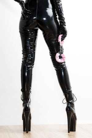 domina: detail of standing woman with pink handcuffs Stock Photo