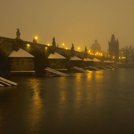 artificial lights: Charles bridge during night in winter, Prague, Czech Republic Stock Photo