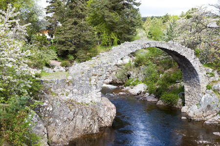 Old Packhorse bridge, Carrbridge, Highlands, Scotland Stock Photo - 26211266
