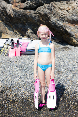 little girl on the beach at sea ready for snorkeling photo