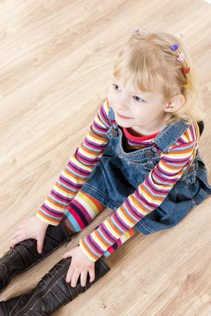 sit: little girl sitting on floor Stock Photo