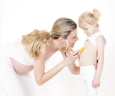 caretaking: little girl with her pregnant mother and stethoscope