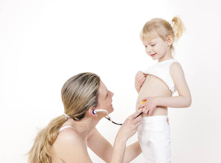 caretaking: little girl with her mother and stethoscope