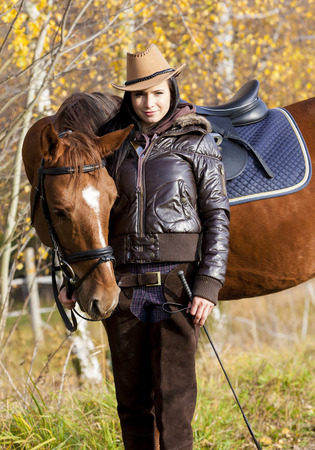 equestrian with her horse in autumnal nature Stock Photo