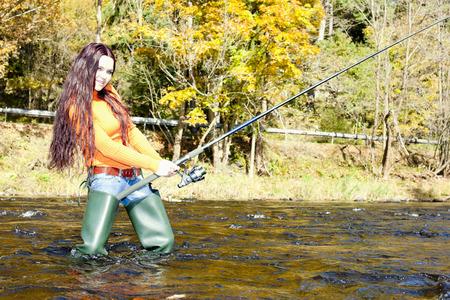 fisherwoman: woman fishing in Otava river, Czech Republic