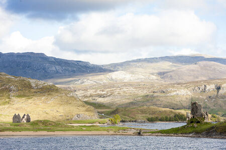 the silence of the world: ruins of Ardvreck Castle and Colda house at Loch Assynt, Highlands, Scotland