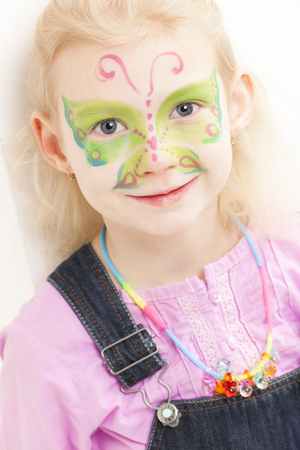 face painting: portrait of little girl with face painting