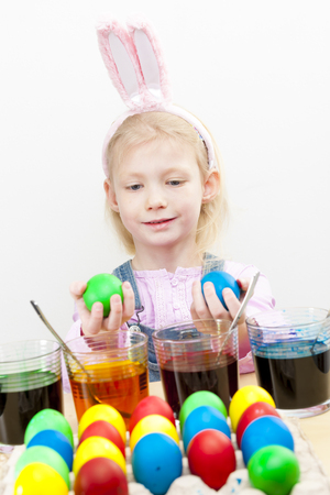 coloration: portrait of little girl during Easter eggs coloration