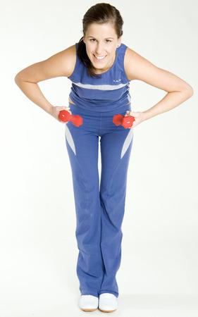dumb: woman exercising with dumb bells