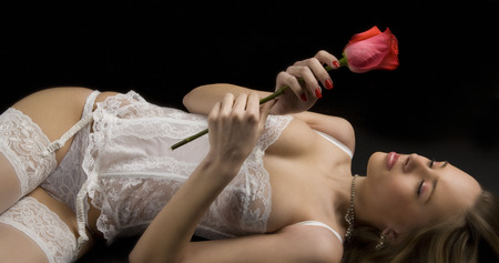 knickers: portrait of lying down woman with rose Stock Photo
