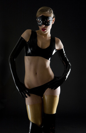 woman wearing latex clothes Stock Photo