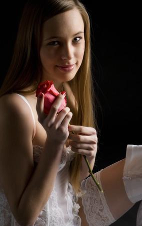 Portrait of Woman holding a rose Standard-Bild - 35659324