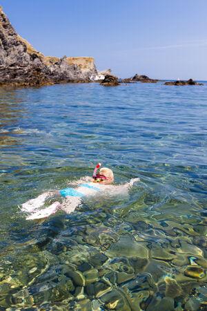child bikini: little girl snorkeling in Mediterranean Sea, France Stock Photo
