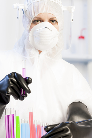 young woman wearing protective clothes in laboratory photo