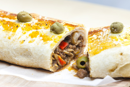 puff roly-poly filled with minced meat and green olives