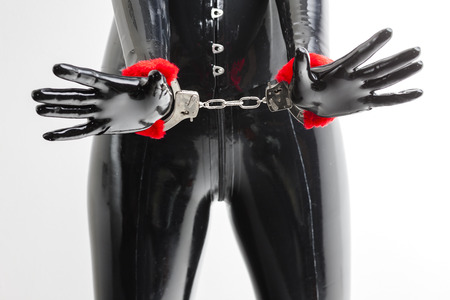 fetishistic: detail of standing woman with handcuffs