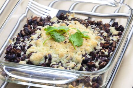 baked black beans with cheese Emmentaler photo