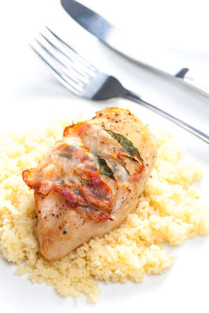 couscous: chicken meat on sage baked with bacon and served with couscous