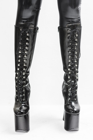 extravagant: detail of standing woman wearing extravagant boots