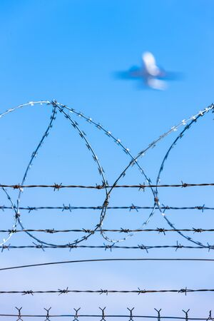 bearded wire: barbed wires at the airport Stock Photo
