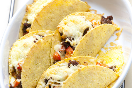 minced beef: baked tacos filled with minced beef meat, beans and tomatoes