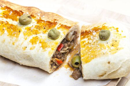 minced meat: puff roly-poly filled with minced meat and green olives