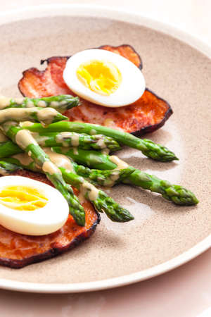 boiled green asparagus with bacon, egg and mustard dip photo