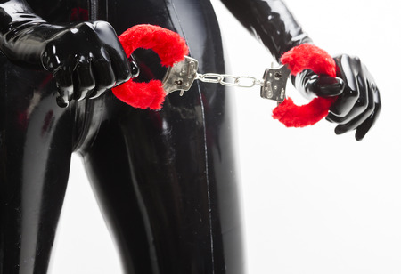domina: detail of standing woman with handcuffs