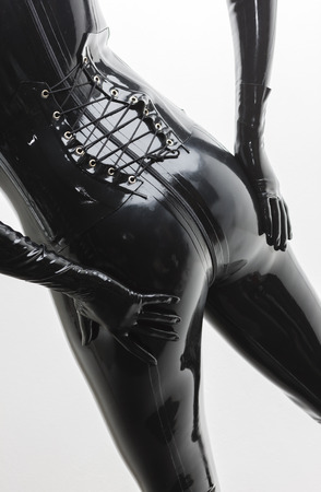 ass standing: detail of standing woman wearing latex clothes