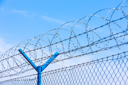 cattle wire wire: barbed wires at the airport Stock Photo