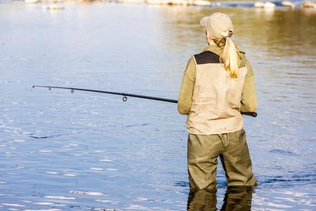 fisherwoman: woman fishing in the river Stock Photo