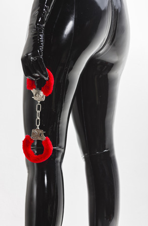 detail of standing woman holding handcuffs photo