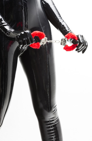 detail of standing woman with handcuffs photo