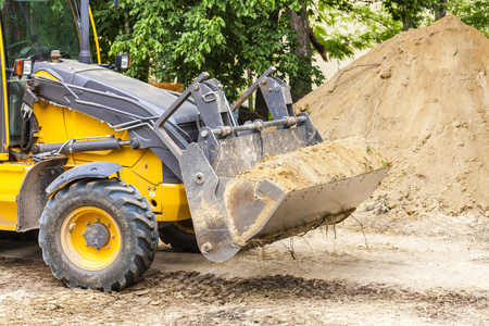 outside machines: excavator at construction site Stock Photo