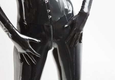 extravagance: detail of standing woman wearing latex clothes