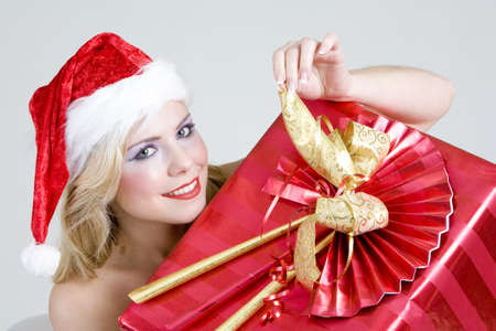 blond haired: Santa Claus with Christmas present