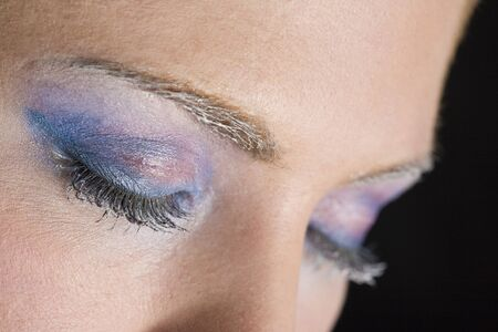 one eye closed: detail of make-up