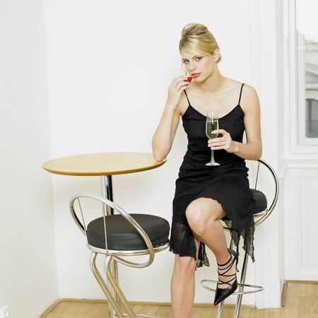 woman with a glass of champagne Stock Photo