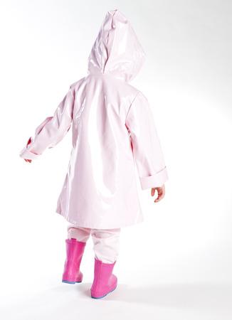 wellingtons: little girl wearing raincoat