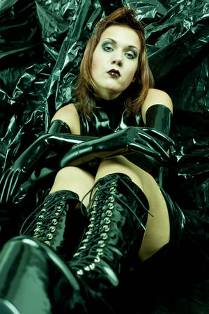 sitting woman wearing latex clothes photo