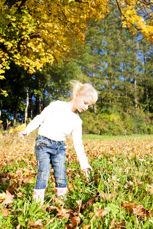 wellingtons: little girl in autumnal nature