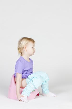 potty: little girl using potty
