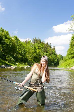 fisherwoman: woman fishing in river, Czech Republic